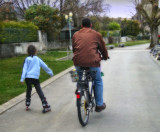 Back portrait of a wheeled family