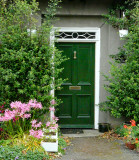 ...and finds an elegant green door, in the little gate lodge