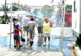 Fairgoers Cool Off in the Shower