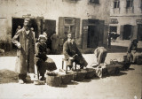 Jewish tradesmen with baskets full of vegetables and fruits on the market