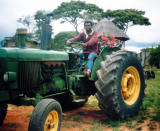 Chai driving the tractor barefoot.jpg