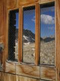 Reflections of the Sierra on the Shelter's door window