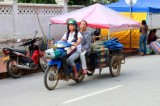 1828 Market traders on bike.jpg
