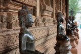 There are many bronze Buddhas around the temple building