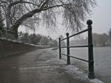 snow fall along footpath.