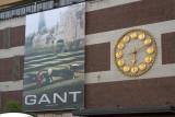 Åhléns department store ad and clock