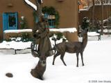 Deer and maiden in snow
