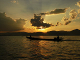 Boat at sunset on Inle Lake.jpg