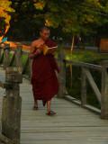 Reading monk on bridge Mandalay.jpg