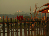Three monks on U Bein Bridge in the morning.jpg
