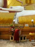 Monk with giant buddha Bago.jpg