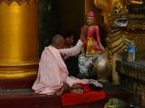 Nun praying at Shwedagon.jpg