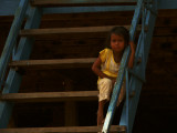 Girl on steps of stilt home Kompong Phluk.jpg