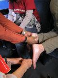 Unknown Samaritan helps bandage Kara's feet