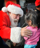 santa greeting needy kids