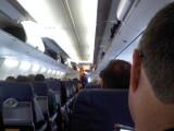 Flight Attendant Wears My Cheesehead to Greet Passengers