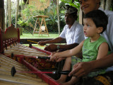 Rahil jamming on the Rindik, a traditional Balinese instrument.