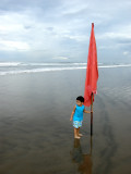 Rahil and flag at Seminyak beach