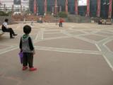 Watching the big kids skate at Ansul Plaza.