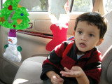 With handmade Christmas ornaments on the way home from school.
