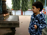 Threatening to blow out the lamps commemorating the Buddha's enlightenment.  Karmic demerit.