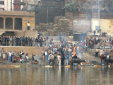 Cremation ghat.  Note stacked firewood in background.