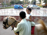 Riding ponies at the Bandstand
