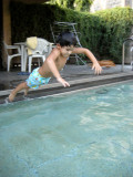 Beating the heat and learning to jump into the pool at the same time.