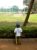 Watching uncles play cricket.