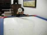 First game of air hockey.