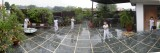 Rahil on terrace in the unceasing rain (5 Sept 2010)