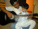 Guitar lesson no. 1.  With Amer, celebrating Eid.