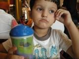 Contemplating his consumption of chocolate ice cream.