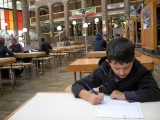 Writing in his journal while in the student union at the University of Western Cape