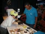 Exploring a hands-on exhibit at the Cape Town Aquarium