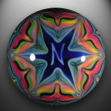 A murrine N is trapped in a complex fumed Web(er), while its companion N blazes forth in glory on the gorgeous backside.