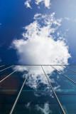 Cloud entering a building