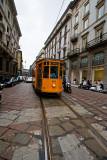 Orange streetcar in Milan