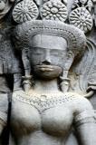 a devata with elaborate headdress