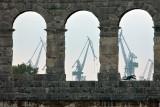 Pula - Amphitheatre and dockyard cranes