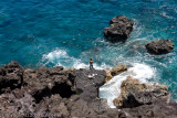 This guy climbed down the rocks (like a goat!) and threw a fishing line in the water and caught fish right away.
