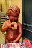 Manneke Pis eating  a waffle