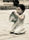 Cute little Thai girl at the Grand Palace, Bangkok
