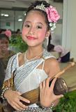 Nervous young Thai girl before performance with percussion instrument
