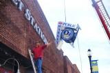 installing new Public Market & oz signage