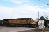 UP 6804 passes sign that states, CNW Main Line.JPG