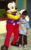 Akef with Mickey in Disneyland