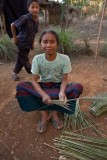 Sorting grass stalks for making brooms