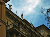 On a rooftop, classical statues9972