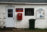 Small town post office in the rain